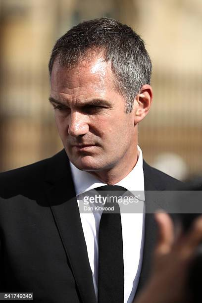 Peter Kyle MP looks at floral tributes in Parliament Square after the service on June 20 2016 in London England Parliament was recalled from recess...