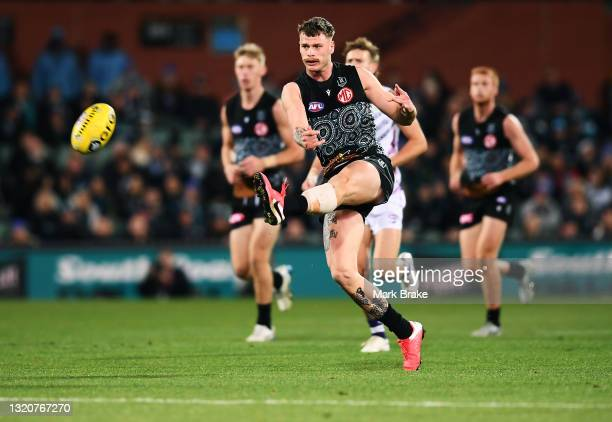 Peter Ladhams of Port Adelaide kicks a goal from 60 metres out during the round 11 AFL match between the Port Adelaide Power and the Fremantle...