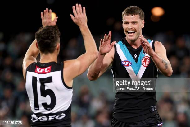 Peter Ladhams of the Power celebrates a goal during the 2021 AFL Round 23 match between the Adelaide Crows and the North Melbourne Kangaroos at...