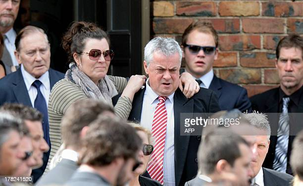 Peter Lane father of Australian baseball player Chris Lane who was killed in the small Oklahoma town of Duncan in the US is surrounded by friends and...