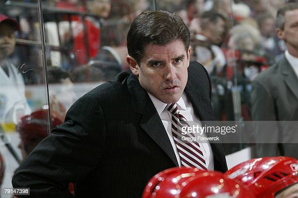 Peter Laviolette head coach of the Carolina Hurricanes watches the action against the Edmonton Oilers during the NHL game at RBC Center on January...