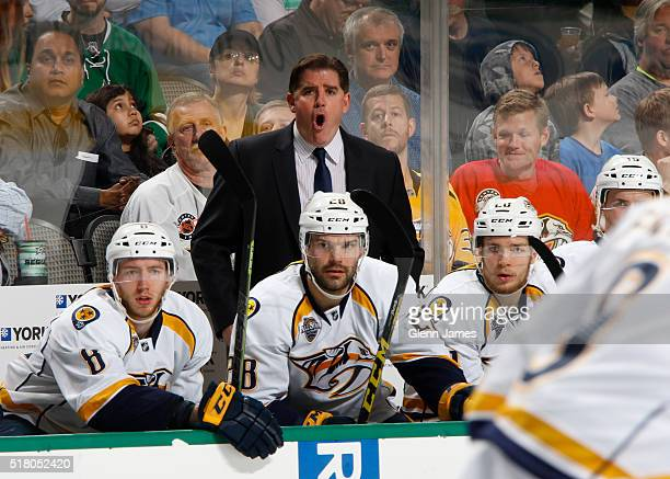Peter Laviolette head coach of the Nashville Predators watches the action from the bench against the Dallas Stars at the American Airlines Center on...