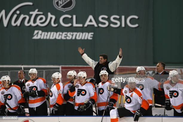 Peter Laviolette head coach of the Philadelphia Flyers reacts during the game against the Boston Bruins during the 2010 Bridgestone Winter Classic at...