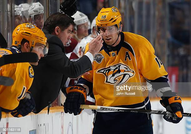 Peter Laviolette of the Nashville Predators coaches James Neal before a faceoff in the final seconds against the Colorado Avalanche during an NHL...