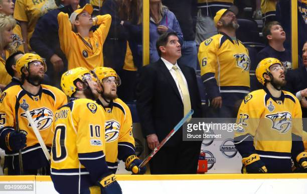 Peter Laviolette of the Nashville Predators looks at the replay against the Pittsburgh Penguins during the second period in Game Six of the 2017 NHL...