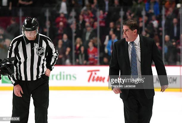 Peter Laviolette of the Nashville Predators speks with referee in action against the Montreal Canadiens in the NHL game at the Bell Centre on January...