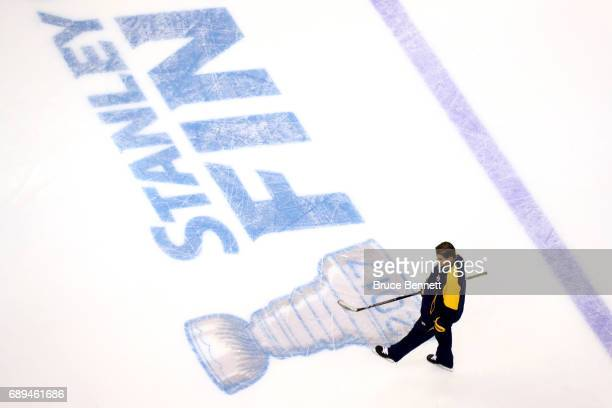 Peter Laviolette of the Nashville Predators walks the ice in practice during Media Day for the 2017 NHL Stanley Cup Final at PPG PAINTS Arena on May...