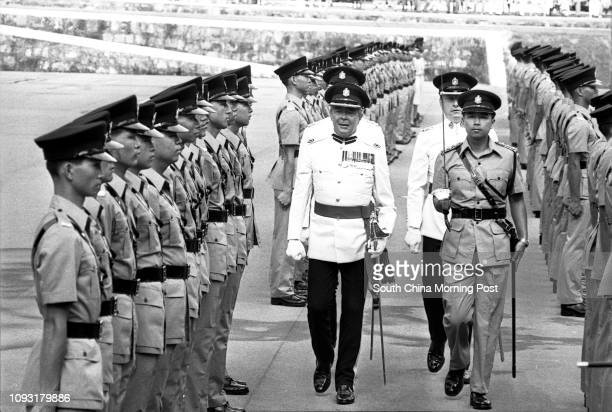 Peter Law Superintendent of the Royal Hong Kong Police Force inspecting a passingout parade staged by police cadets at the Police Training School in...