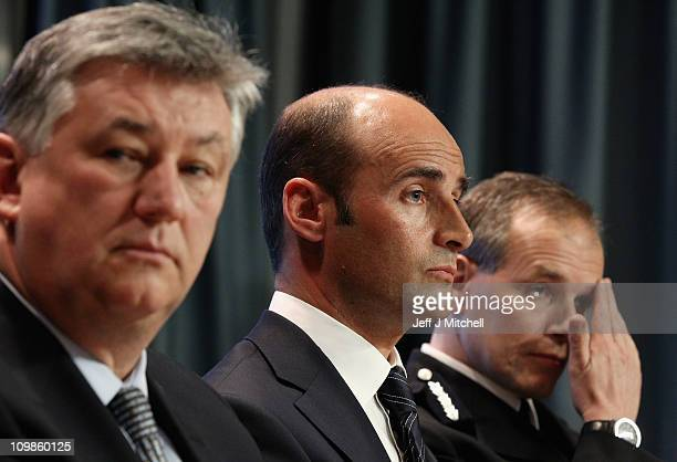 Peter Lawell chief executive of Celtic Martin Bain chief executive of Rangers and Stephen House Strathclyde Police Chief Constable attend a media...