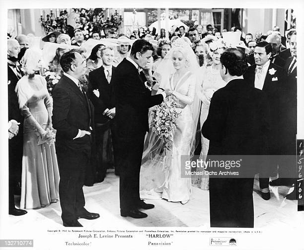 Peter Lawford and Carroll Baker getting married with Martin Balsam Red Buttons Angela Lansbury and Raf Vallone in the audience in a scene from the...