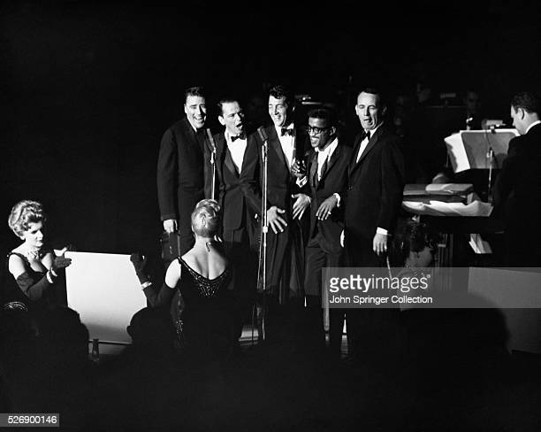 Peter Lawford Frank Sinatra Dean Martin Sammy Davis Jr and Joey Bishop performing