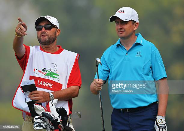 Peter Lawrie of Ireland and caddie discuss a shot during the second round of the Hero India Open Golf at Delhi Golf Club on February 20 2015 in New...