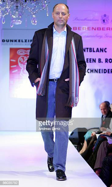 Peter Lewandowski chief editor of Gala magazine poses on the catwalk during the fashion charity Gala Event Prominent at the Atlantic Hotel on October...