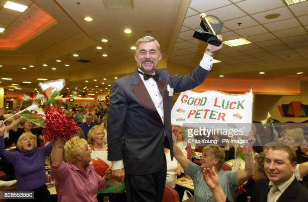 Peter Lewis from the Castle Bingo in Cardiff celebrates with his supporters after winning the title of Bingo Caller of the Year Award at the Mecca...