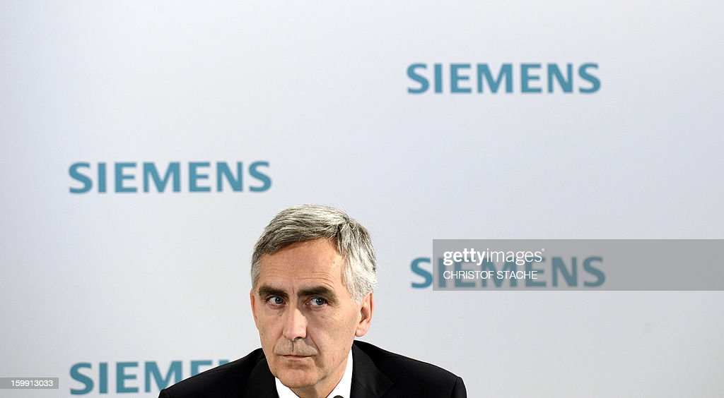 Peter Loescher, CEO of German industrial giant Siemens, attends a press conference ahead of the company's shareholders meeting on January 23 , 2013 in Munich, southern Germany. Siemens said on January 23, 2013 that earnings and orders fell in the first quarter, but it was hoping a shake-up of its businesses would nevertheless enable it to meet its full-year targets.