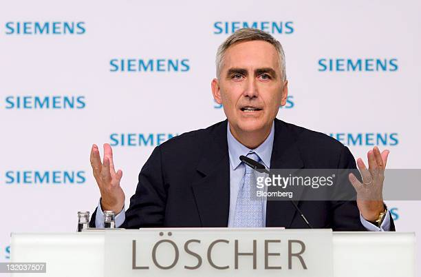 Peter Loescher chief executive officer of Siemens AG gestures during a news conference in Munich Germany on Thursday Nov 10 2011 Siemens AG Europe's...