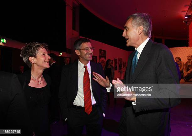 Peter Loescher talks to Herbert Hainer and Angelika Hainer at the Uli Hoeness' 60th birthday celebration at Postpalast on January 13 2012 in Munich...
