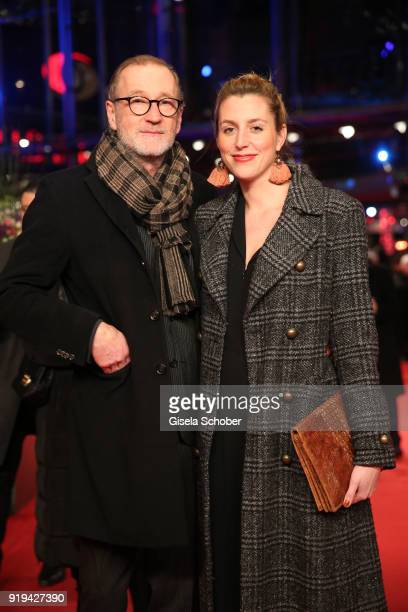 Peter Lohmeyer and his girlfriend Leonie Seifert attend the 'Transit' premiere during the 68th Berlinale International Film Festival Berlin at...