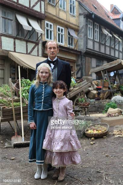 Peter Lohmeyer as Sebastian Isabelle Ottmann as Klara Sesemann and nine year old actress Anuk Steffen as Heidi stand on the set during filming on the...