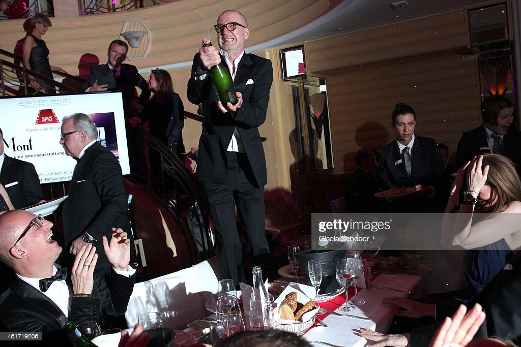 Peter Lohmeyer splash champaign during the German Filmball 2015 at Hotel Bayerischer Hof on January 17, 2015 in Munich, Germany.