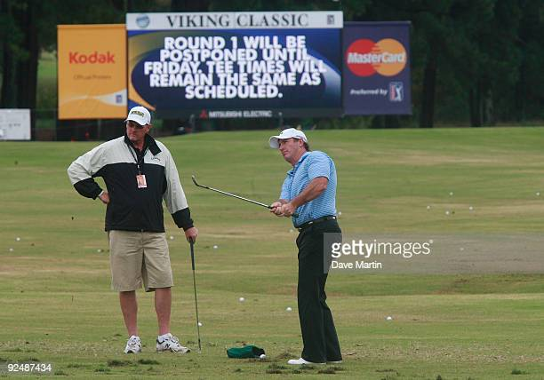 Peter Lonard of Australia chips at the practice range after first round play was postponed because of weather in the Viking Classic at the Annandale...