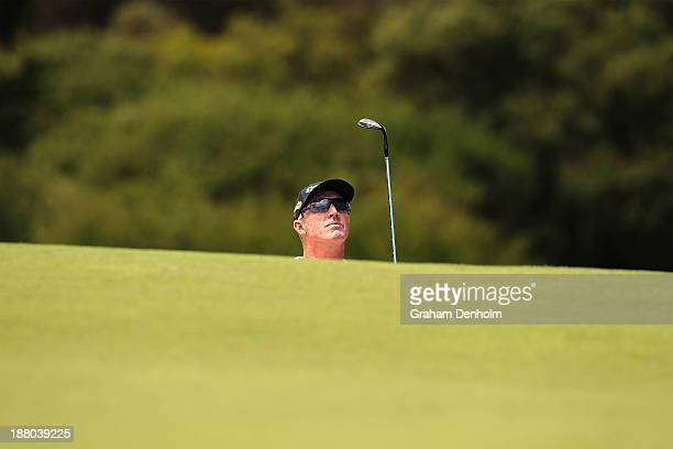 Peter Lonard of Australia chips from the bunker during round two of the 2013 Australian Masters at Royal Melbourne Golf Course on November 15 2013 in...