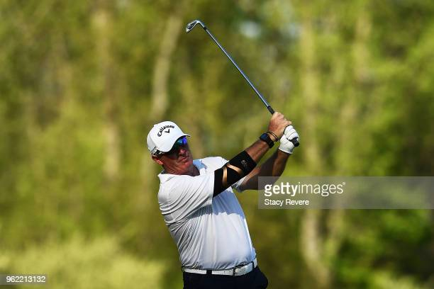 Peter Lonard of Australia hits his second shot on the 16th hole during the first round of the Senior PGA Championship presented by KitchenAid at the...
