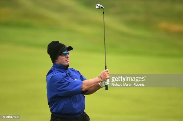 Peter Lonard of Australia hits his second shot on the 2nd hole during the second round of the Senior Open Championship presented by Rolex at Royal...