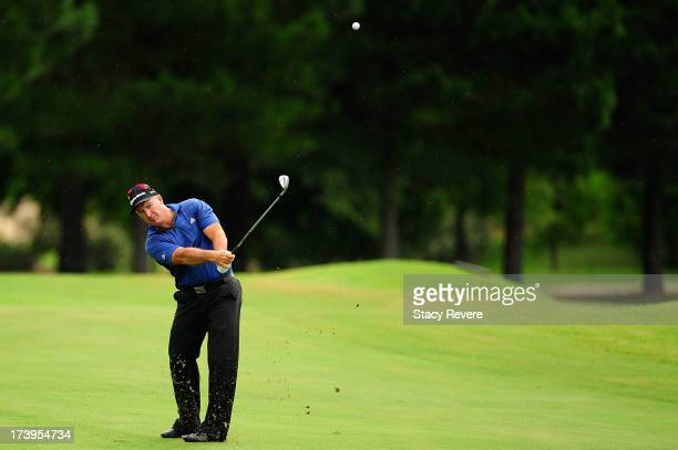 Peter Lonard of Australia hits his second shot on the third hole during the first round of the Sanderson Farms Championship at Annandale Golf Club on...