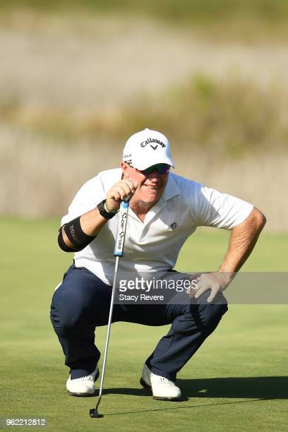 Peter Lonard of Australia lines up a putt on the 16th green during the first round of the Senior PGA Championship presented by KitchenAid at the Golf...