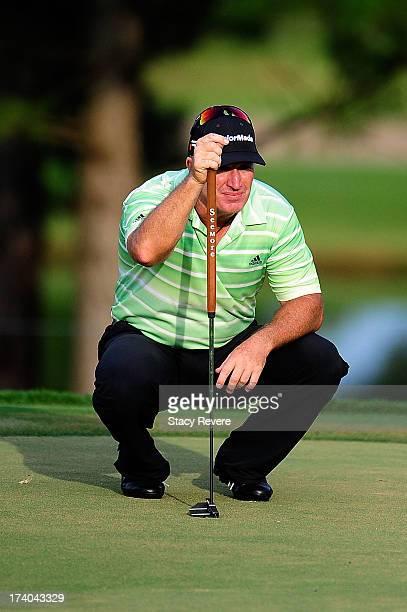 Peter Lonard of Australia lines up his putt on the fourth hole during the second round of the Sanderson Farms Championship at Annandale Golf Club on...