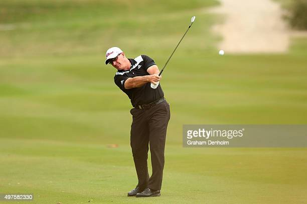 Peter Lonard of Australia plays a shot from the fairway during the ProAm ahead of the 2015 Australian Masters at Huntingdale Golf Course on November...