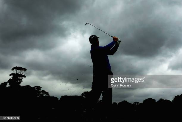 Peter Lonard of Australia plays an approach shot during previews ahead of the 2013 Australian Masters at Royal Melbourne Golf Course on November 12...