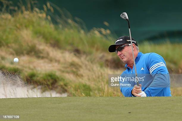 Peter Lonard of Australia plays out of the bunker during previews ahead of the 2013 Australian Masters at Royal Melbourne Golf Course on November 12...