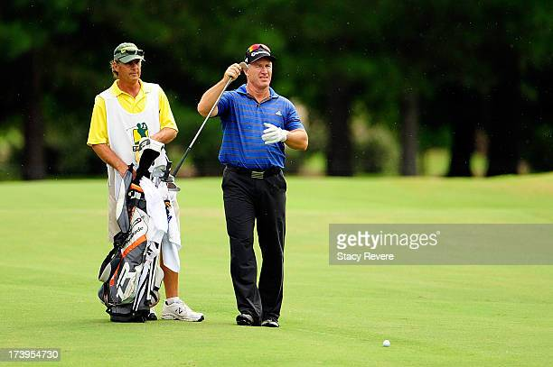 Peter Lonard of Australia pulls a club for his second shot on the third hole during the first round of the Sanderson Farms Championship at Annandale...