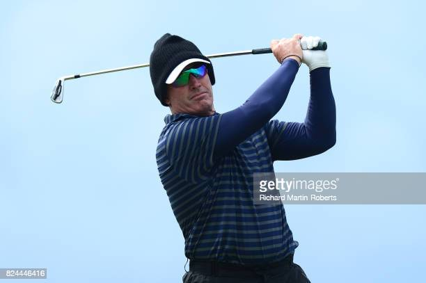 Peter Lonard of Australia tees off on the 10th hole during the final round of the Senior Open Championship presented by Rolex at Royal Porthcawl Golf...