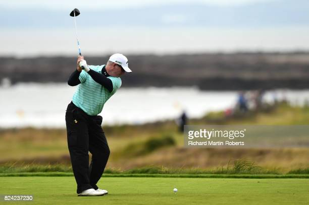 Peter Lonard of Australia tees off on the 3rd hole during the third round of the Senior Open Championship presented by Rolex at Royal Porthcawl Golf...
