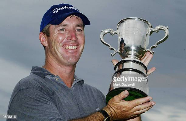 Peter Lonard of NSW holds the Stonehaven Cup after winning the 2003 Australian Open at Moonah Links on December 21 2003 in Melbourne Australia