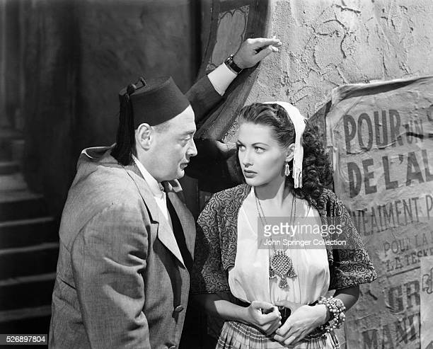 Peter Lorre as Slimane and Yvonne De Carlo as Inez in the 1948 film Casbah