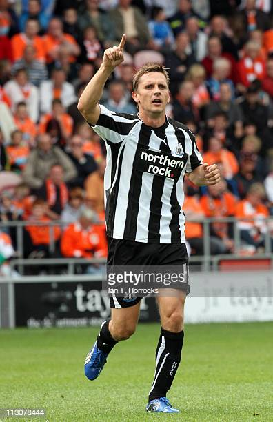 Peter Lovenkrands celebrates after he scored the opening goal during the Barclays Premier League game between Blackpool and Newcastle United at...