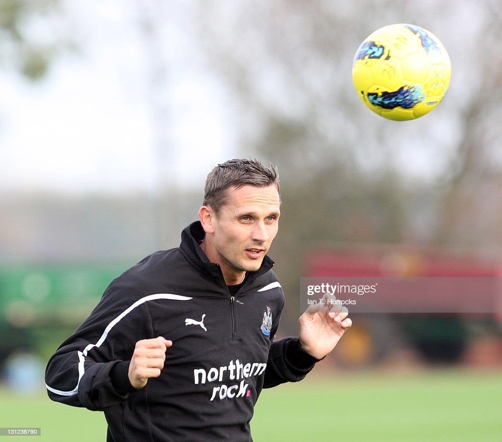 Peter Lovenkrands heads the ball during a Newcastle United Training session at The Little Benton Training Ground on November 03, 2011 in Newcastle, United Kingdom.