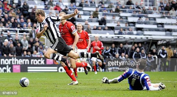 Peter Lovenkrands of Newcastle is tripped by Barnsley goalkeeper Luke Steele leading to the keeper being sent off and Newcastle's first goal from the...