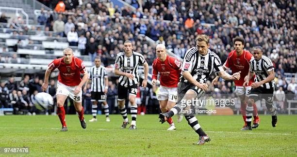 Peter Lovenkrands of Newcastle scores his team's first goal from the penalty spot during the CocaCola championship match between Newcastle United and...