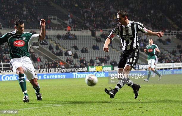 Peter Lovenkrands of Newcastle scores the opening goal during the third round replay match of The FA Cup, sponsored by E.ON, between Newcastle United...