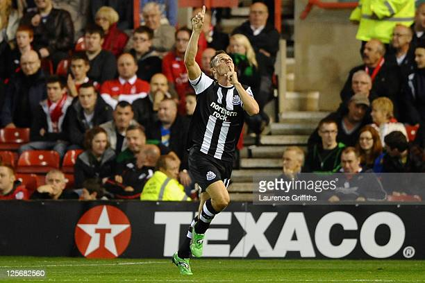 Peter Lovenkrands of Newcastle United celebrates scoring the opening goal during the Carling Cup Third Round match between Nottingham Forest and...