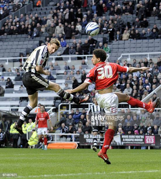 Peter Lovenkrands of Newcastle United scores the second goal during the CocaCola championship match between Newcastle United and Barnsley at St...