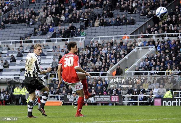Peter Lovenkrands of NewcastleUnited scores the second goal during the CocaCola championship match between Newcastle United and Barnsley at St James'...