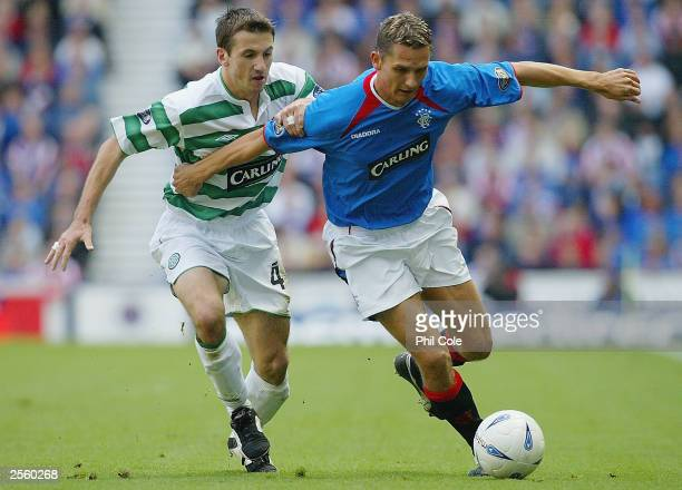 Peter Lovenkrands of Rangers gets to grips with Jackie McNamara of Celtic during the the Scottish Premier division match between Rangers and Celtic...