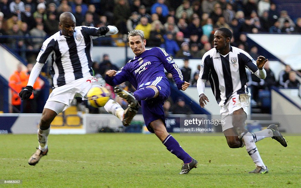 Peter Lovenkrands shoots under challenge from with Abdoulaye Meite (L) and Leon Barnett during the Barclays Premier League game between West Bromwich Albion and Newcastle United at the Hawthorns on February 07, 2009, in West Bromwich, England.