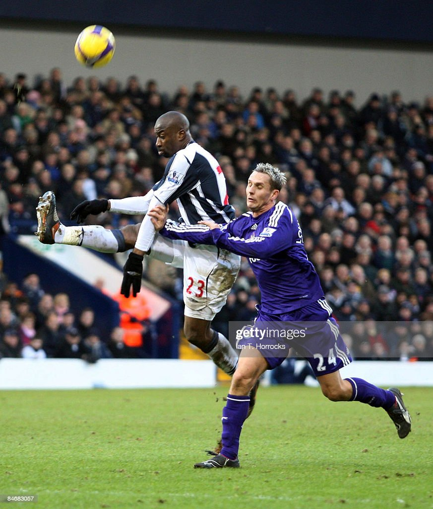 Peter Lovenkrands tussels with Abdoulaye Meite (L) during the Barclays Premier League game between West Bromwich Albion and Newcastle United at the Hawthorns on February 07, 2009, in West Bromwich, England.